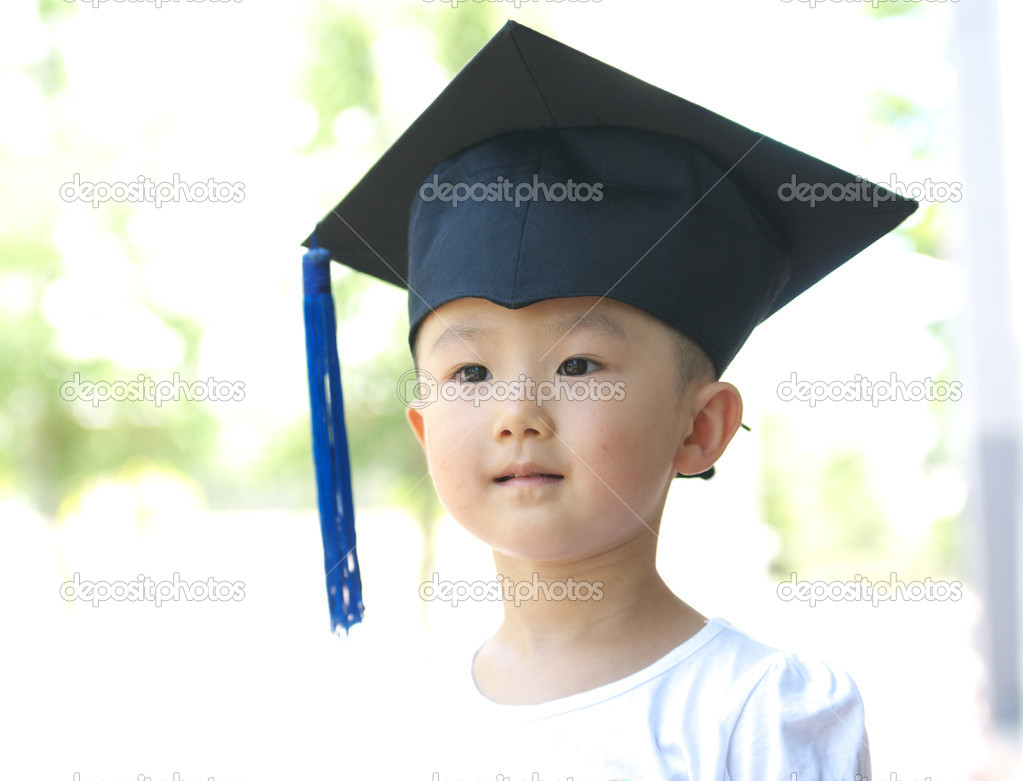 Baby with gown hat — Stock Photo © WilliamJu #6114233
