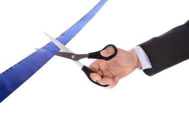 A man cutting a ribbon