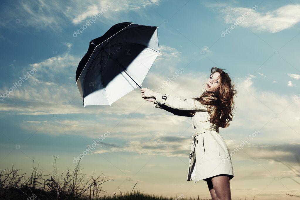 Fashion portrait of elegant woman in a raincoat
