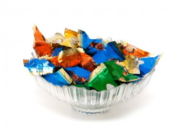 Glass vase with candy in colorful wrappers