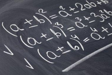 Mathematical equations on blackboard
