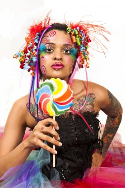 Retro image of a young woman holding a lollipop.