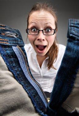 Surprised girl looking inside unzipped pants