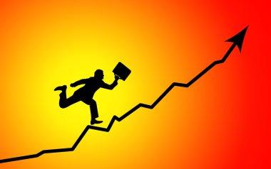 Businessman running to graph peak