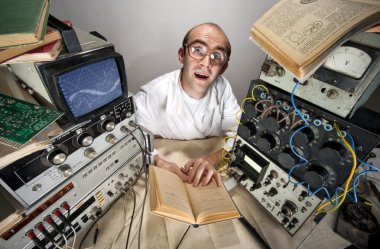 Funny timid scientist reading book