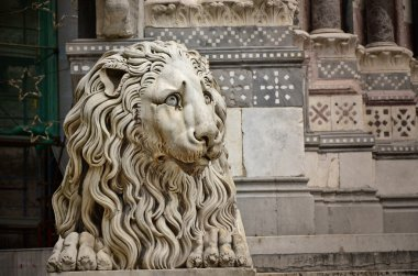 Lion sculpture in front of the Cathedral of St. Lawrence, Genoa, Italy