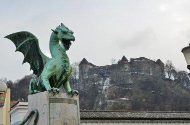 Ljubljana castle in the background of the Dragon bridge