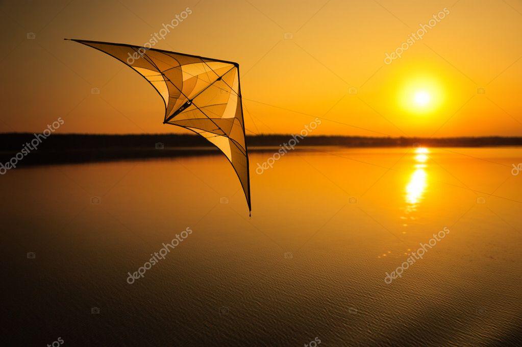 Kite flying at sunset