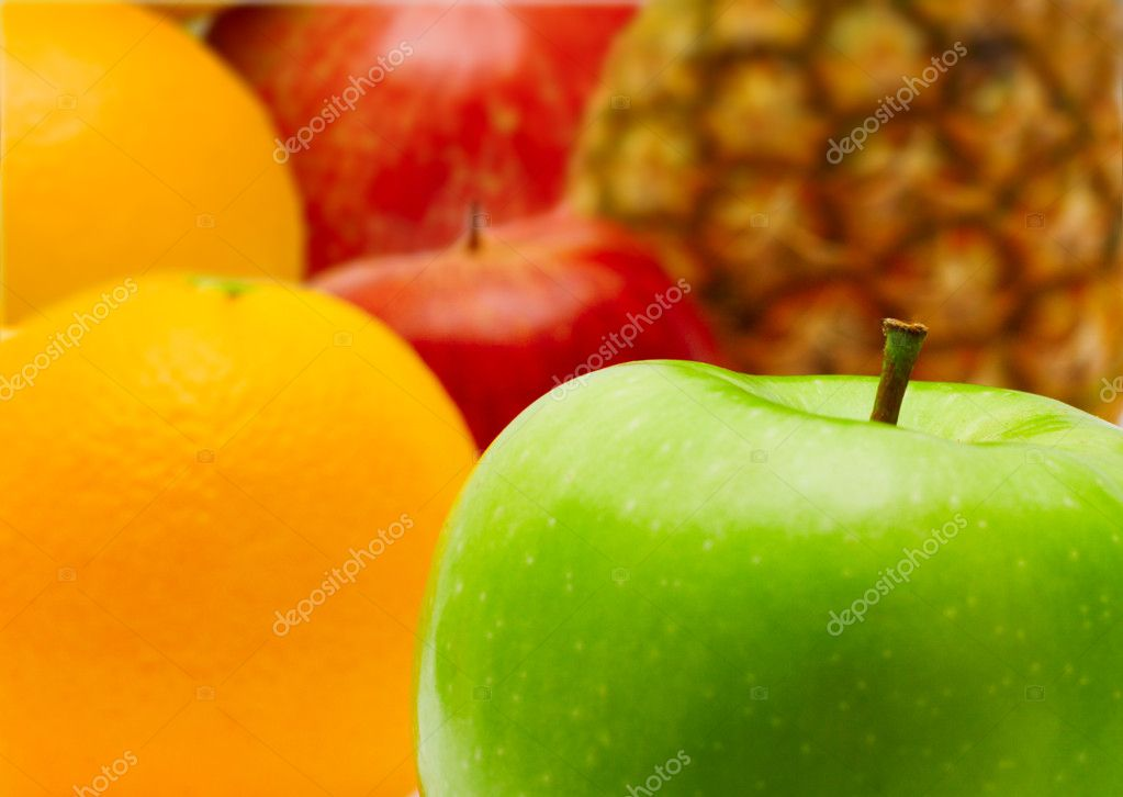 Fresh apple and citrus fruit closeup