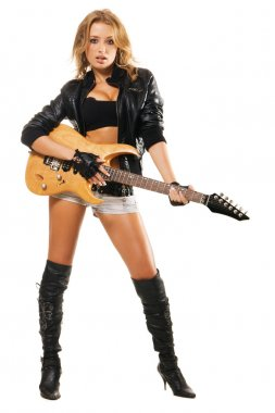 Sexy girl with electric guitar against