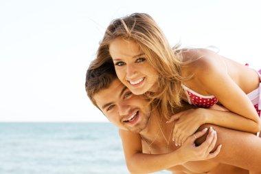 Beautiful couple having fun on the seaside