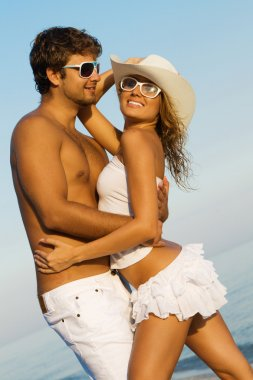 Young stylish couple on a sea shore