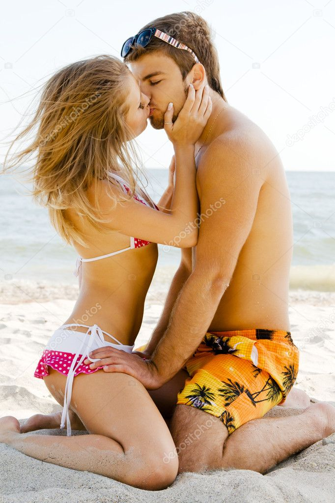 Beautiful couple kissing on the seaside
