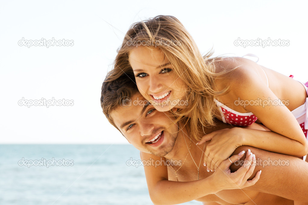 Beautiful couple having fun on the seaside