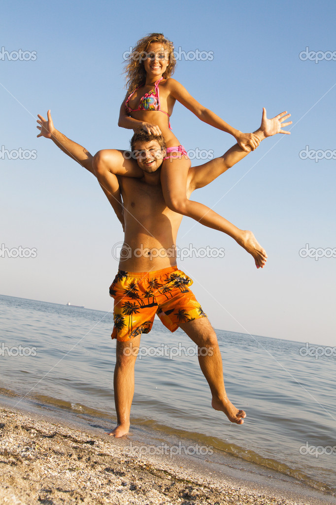 Funny young couple on the seaside
