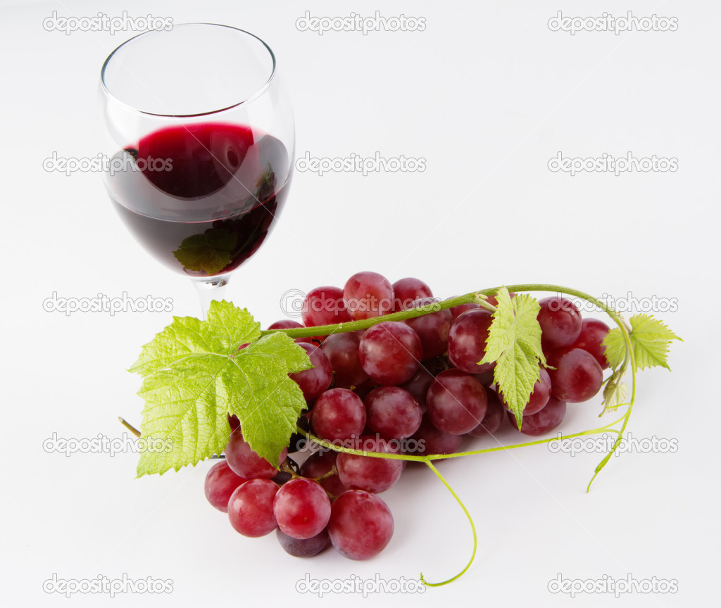 Glass of red wine with grapes — Stock Photo © gdolgikh ...