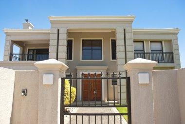 Big house behind gate