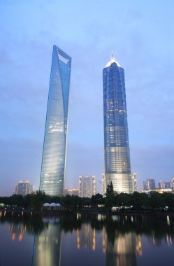 SHANGHAI - JUNE 14: Jin Mao Tower and Shanghai word financial center (who i