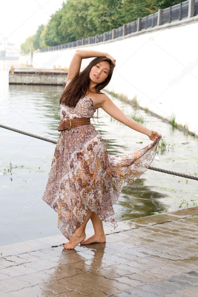 Beautiful girl walking near river