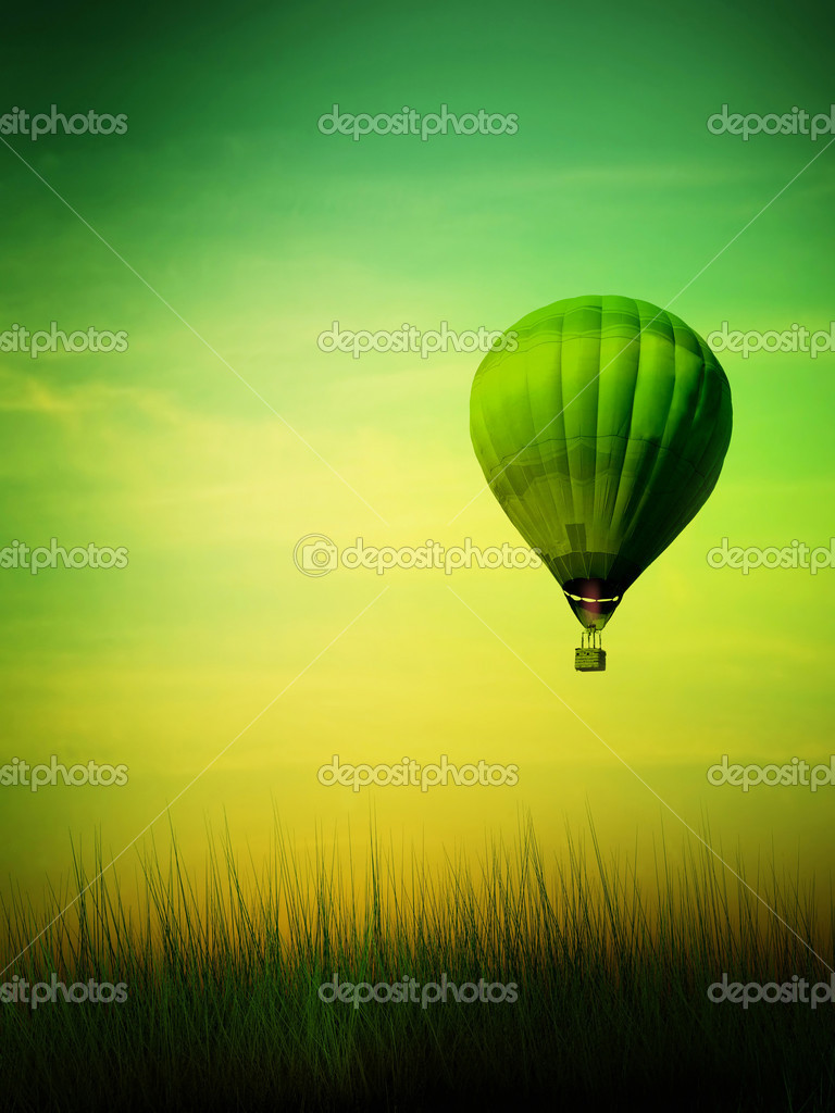 Hot air balloon flying at sunrise