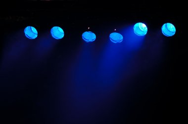 Blue spotlights and smoke