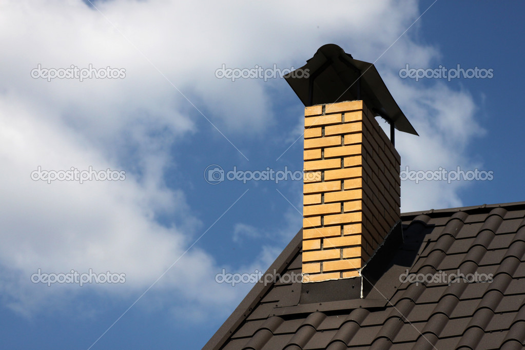 Chimney on a roof of house