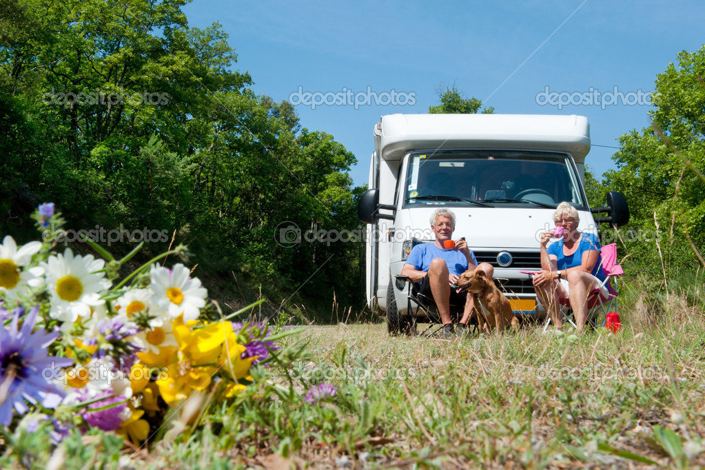 Couple is traveling by camping car