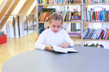 Child reading in library