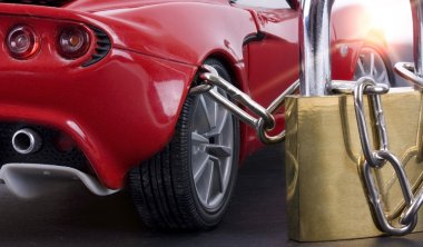 Car chained with padlock close up