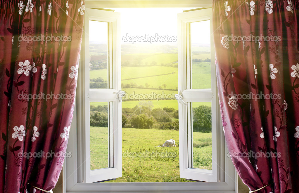 Open window with countryside view and sunlight