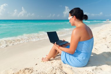 Woman with laptop sitting at the Caribbean sea stock vector