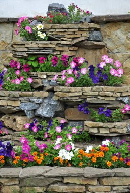 The stone flower bed on the wall