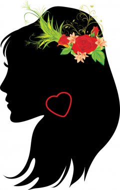 Portrait of beautiful woman with bouquet in hair
