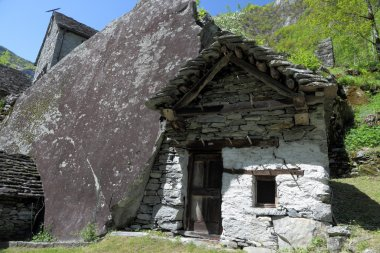 House build in rock in Ticino mountains