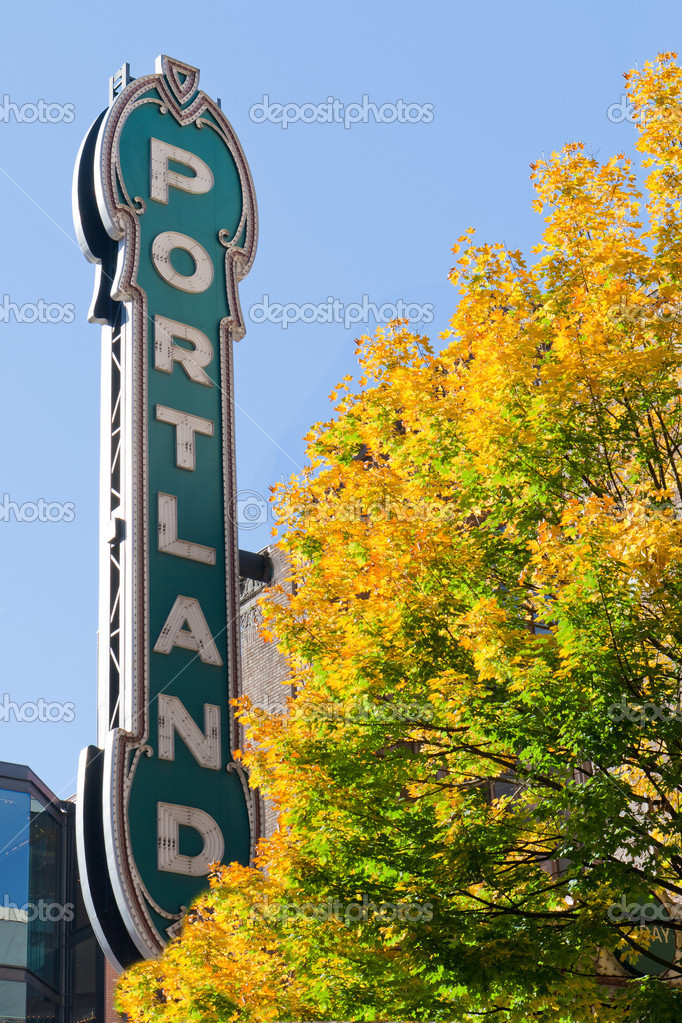 Portland Oregon neon sign with fall trees