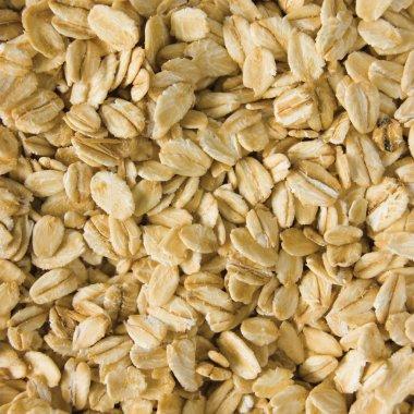 Oatmeal background, rolled raw oats macro closeup