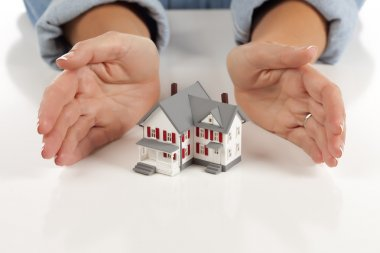 Womans Hands Around Model House