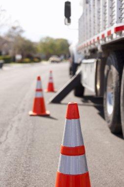 Orange Hazard Safety Cones and Work Truck