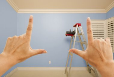 Hands Framing Blue Painted Wall Interior