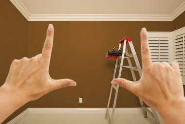Hands Framing Brown Painted Wall Interior
