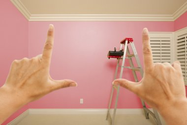 Hands Framing Pink Painted Wall Interior