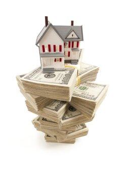 Small House on Stacks of Hundred Dollar Bills