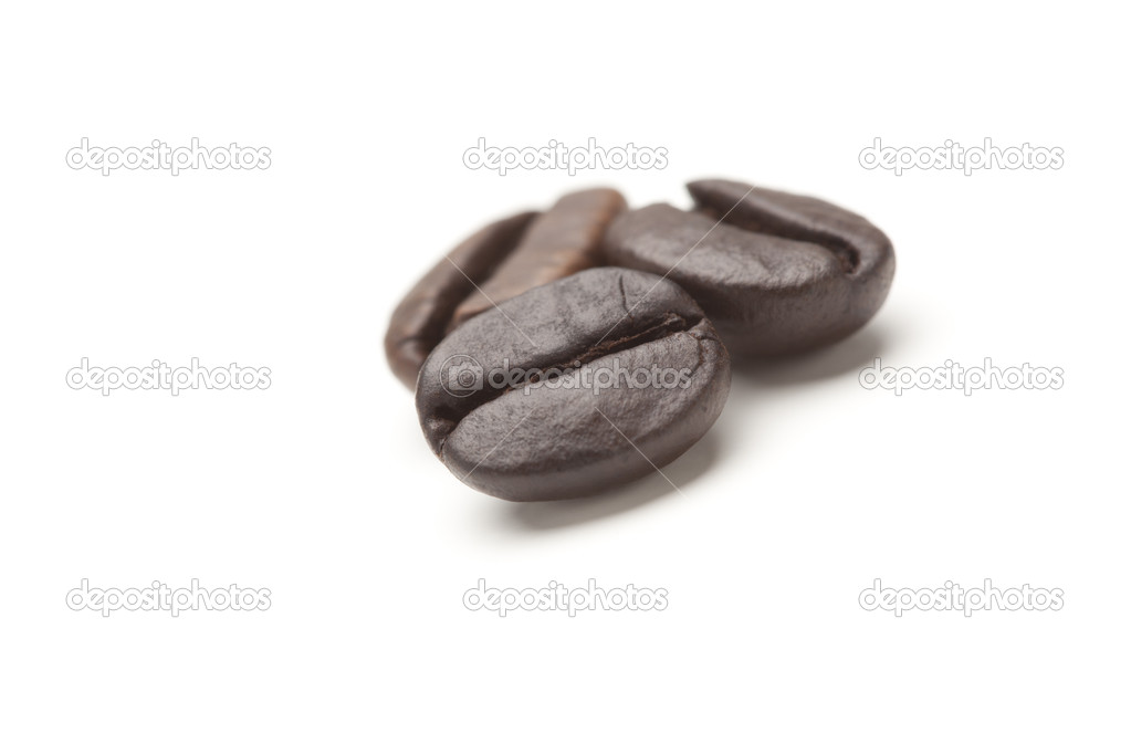 Three Roasted Coffee Beans on White