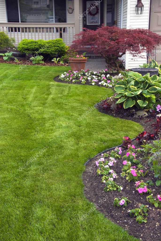a beautifully maintained yard and garden at a residential home photo by fotomine - Yard And Garden
