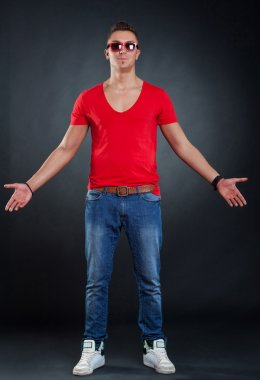 Young man with his arms open