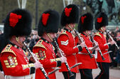 Photo Queens guards marching and playing music