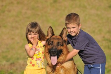 Boy and girl with German shepherd
