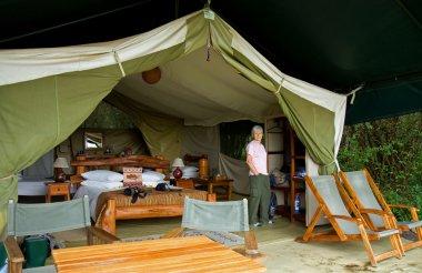 Woman in luxury safari tent