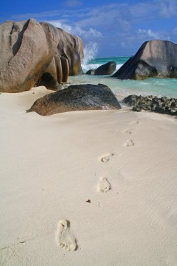 Beach with granite boulders and foot marks