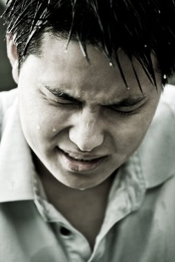 Sad and depressed young asian man